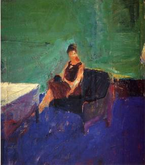 seated-woman-green-interior