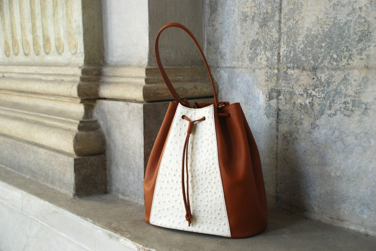 brown _ white drawstring bag